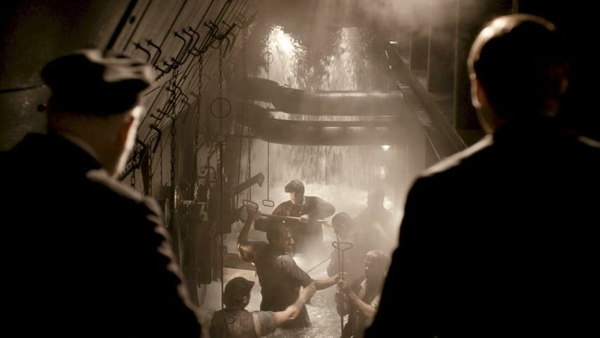 workers from Titanic's boiler rooms struggle as water fills in (from the film Titanic)